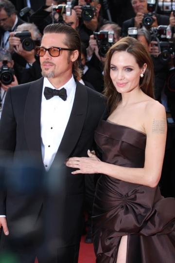 Angelina si Brad Pitt, surprinsi de VIP la concertul Muse de la Londra